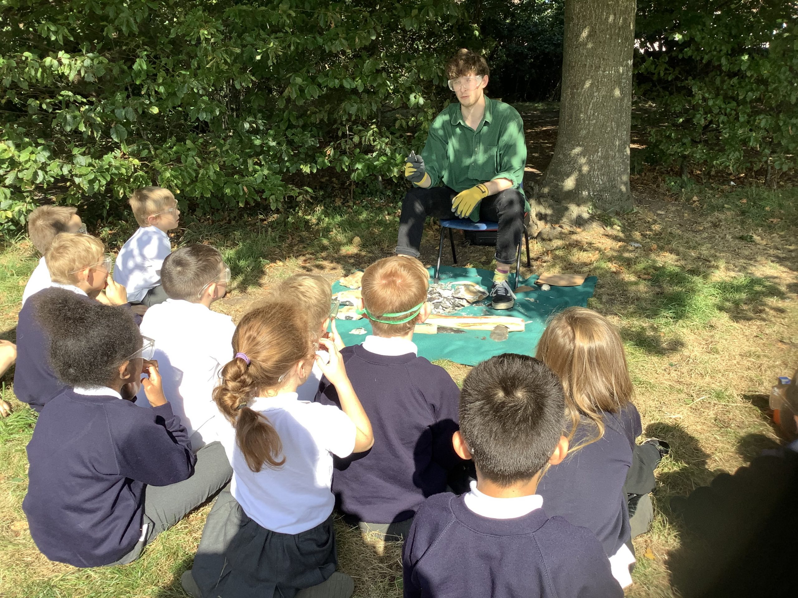 Y3 gallery In year 3, we were very lucky to have a visitor in on Friday who showed the children how to knap flint to make a hand axe. Plus, we get to keep the 'Stone Age' tools he made for each class while he answered all our questions. He used an antler to create the perfect shape. Wow!
